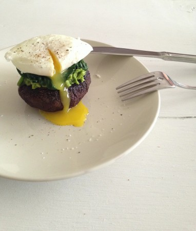 Poached egg over spinach, avocado and portobello mushroom caps