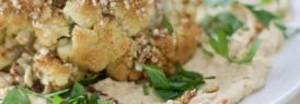 Whole roasted cauliflower with almond crust
