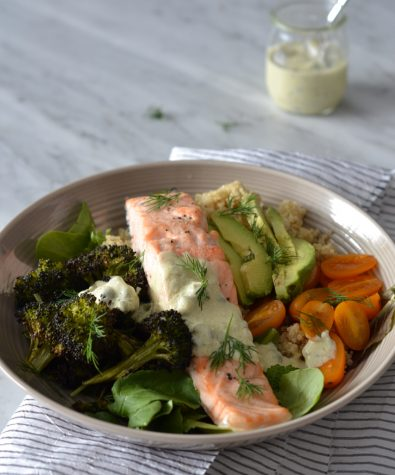 Salmon and quinoa meal prep bowl with creamy caper dressing